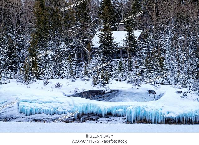 Cottage and icicles at shoreline of Georgian Bay, Tobermory, Ontario, Canada