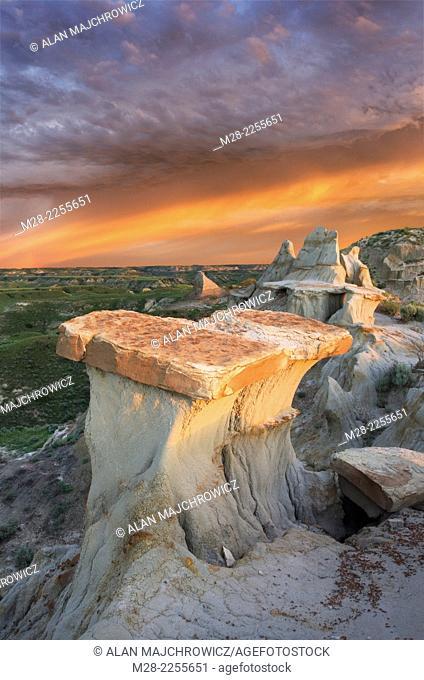 Clearing storm at sunrise over badlands sandstone formations, Theodore Rossevelt National Park, North Dakota