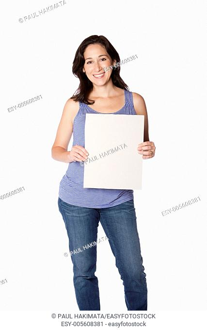 Happy smiling young woman holding whiteboard sign, isolated
