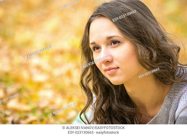 Twenty-five young beautiful girl walks by Europeans autumn forest