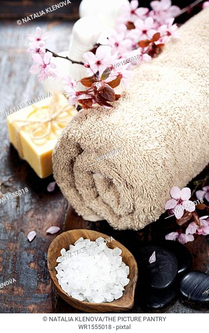 Spa setting over wooden background