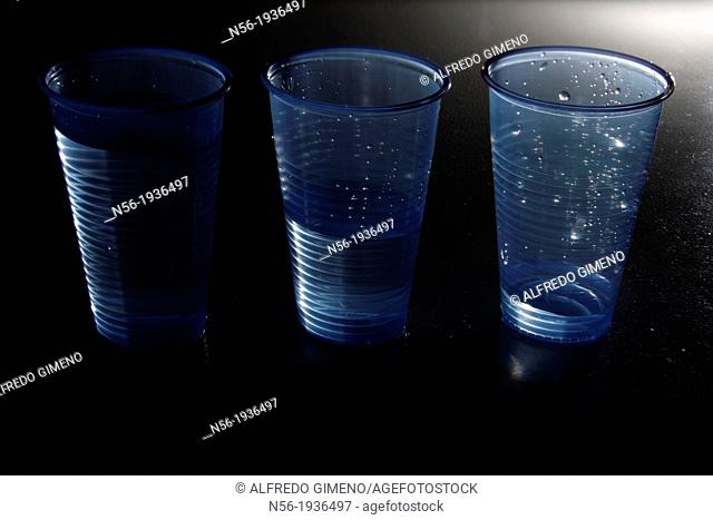 Plastic glasses with water