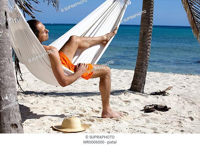 Man beach hammock