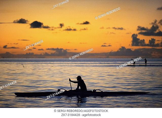 Rowing at sunset in Tahiti, French Polynesia, Tahiti Nui, Society Islands, French Polynesia, South Pacific