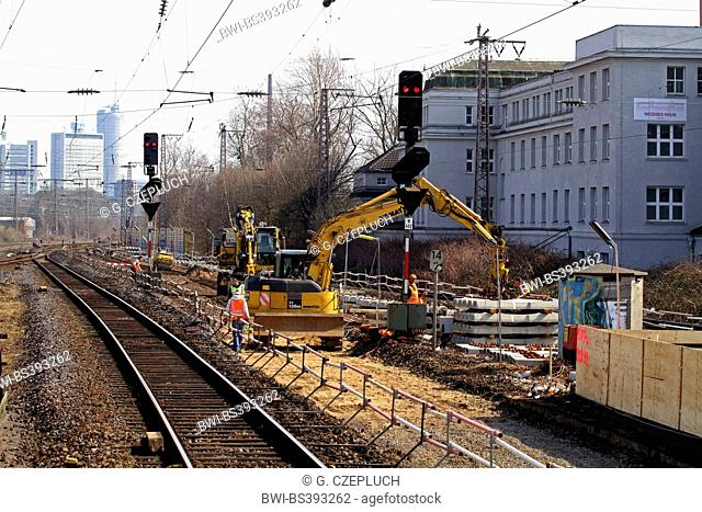 railway construction with rail-roader excavator, Germany