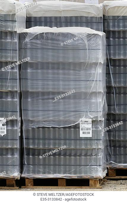 Stacks of thousands of wine bottles wait to be filled at a winery at the end of the harvest