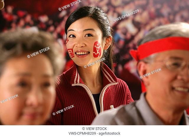 a girl cheering in stadium