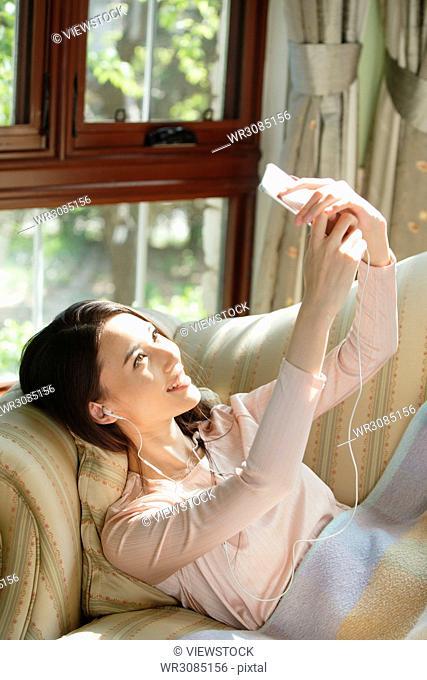 Young women watch mobile phones