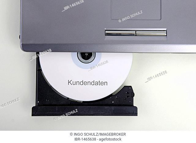 CD labelled Kundendaten, German for customer data, in a computer drive, symbolic image for illegal trade with customer data, breach of data protection