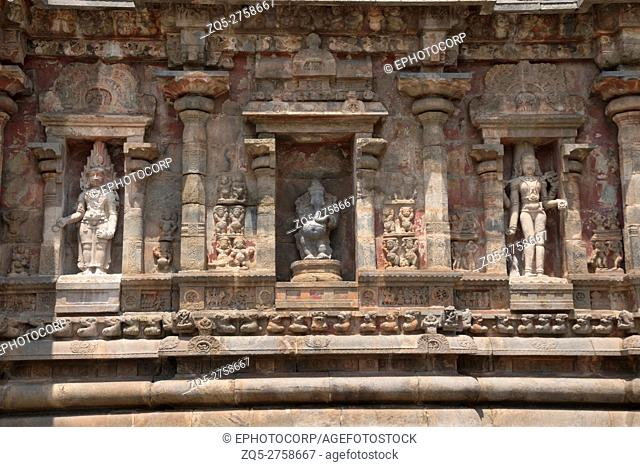 Deities, Southern niche of shrine wall, Airavatesvara Temple, Darasuram, Tamil Nadu, India. From left - Yama, Ganesha, Bhikshatana-murti