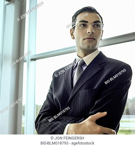 Middle Eastern businessman with arms crossed