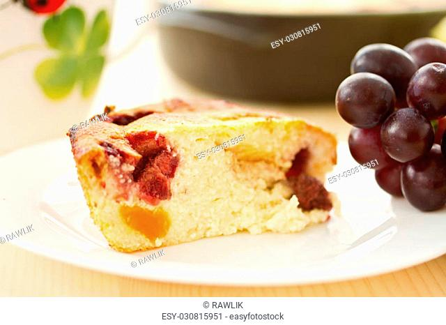 Cottage cheese cake with fruit on a plate