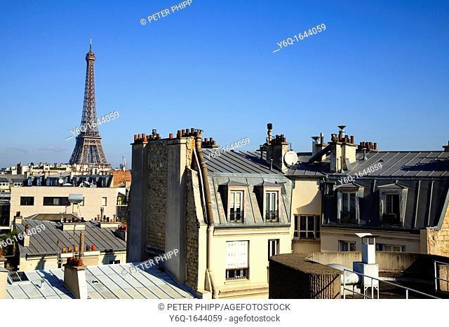 Eiffel Tower across roof tops in Paris, France