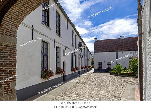 White beguines' houses in courtyard of the Beguinage of Oudenaarde, East Flanders, Belgium