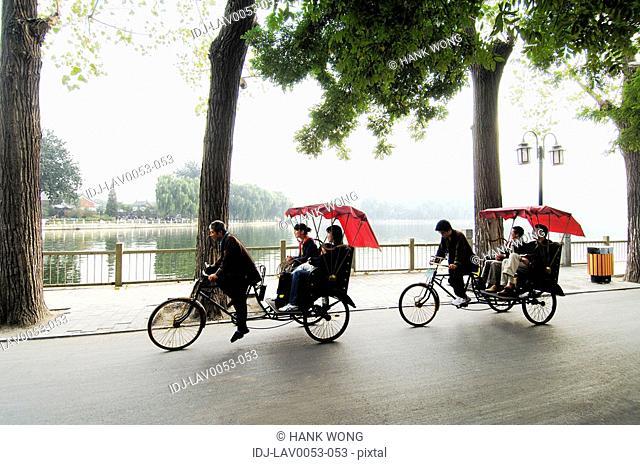 Tourists traveling in rickshaws, Beijing, China