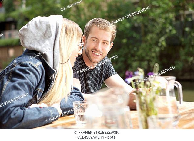 Couple having lunch by canal