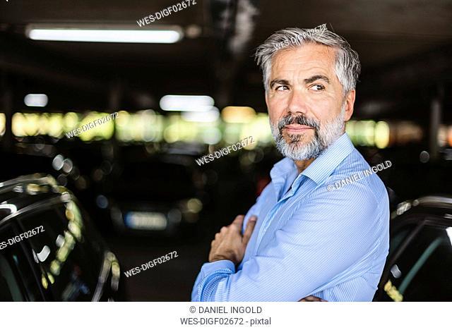 Portrait of businessman in parking garage