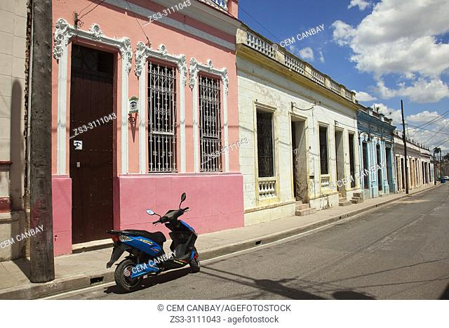 Motorcycle in front of the colonial buildings at the historic center, Camagüey, Cuba, West Indies, Central America