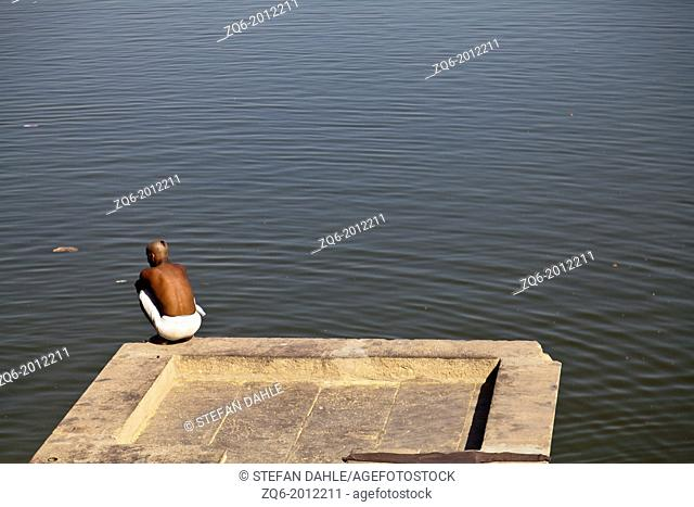 Man on the Banks of the River Ganges in Varanasi, India