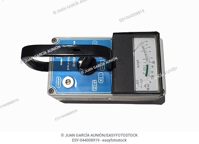 Hand-held radiation survey instrument. Isolated over white background