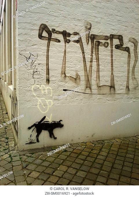 Graffiti on corner of building, on a side street in the old city of Maastricht
