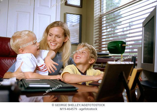 mother with kids in a home office