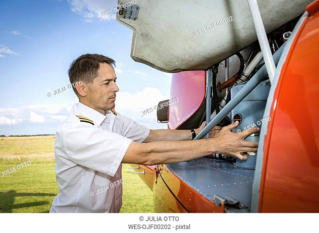 Pilot checking helicopter before start