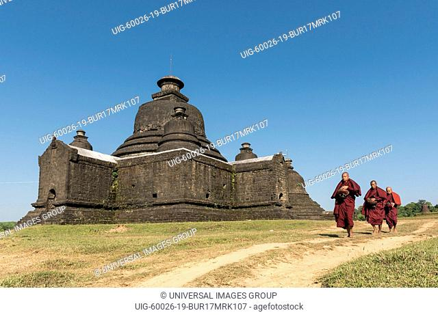 Buddhist monks collect morning alms in front of Laymyetnha, Lemyethna Temple in Mrauk U, Burma, Myanmar