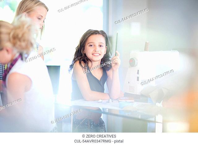 Girls playing fashion designers