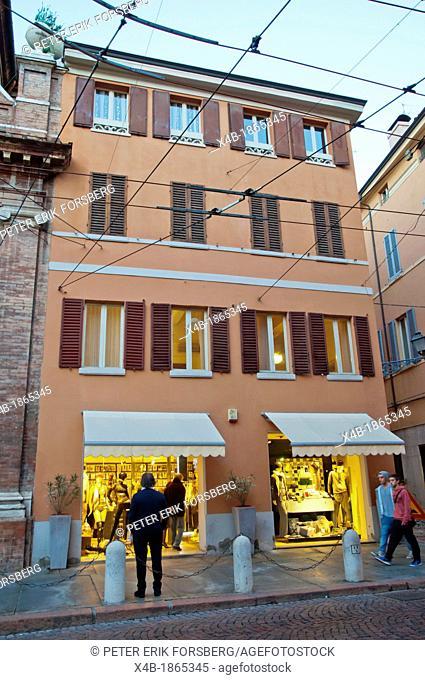 Shops at dusk along Via Emilia street central Modena city Emilia-Romagna region central Italy Europe