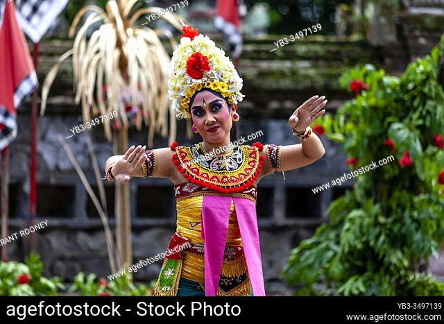 A Female Performer Dancing During A Traditional Balinese Barong and Kris Dance Show, Batabulan, Bali, Indonesia