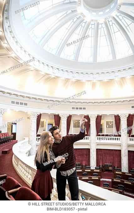 Caucasian teenagers touring capitol building