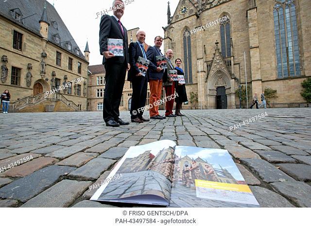 Mayor of Osnabrueck Wolfgang Griesert (L-R), city planner Paul Barron, photographer Hermann Pentermann, author Frank Henrichvark and city planer Brigitte...