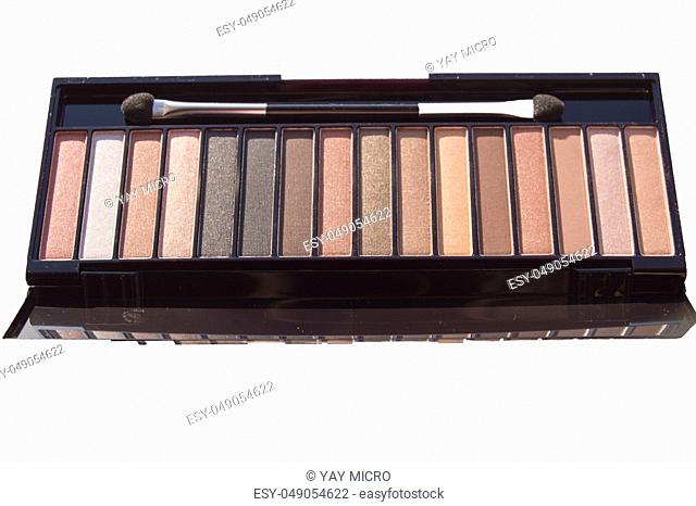 Cosmetic set of Nude eyeshadow with brush in black case isolated on white background