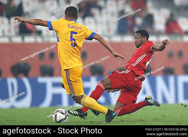 11 February 2021, Qatar, Ar-Rayyan: Bayern Munich's David Alaba (R) and Tigres' Rafael Carioca battle for the ball during the FIFA Club World Cup final soccer...
