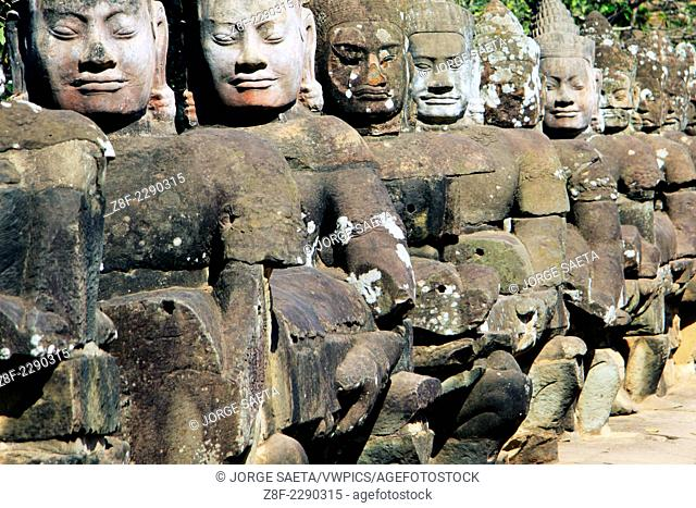 Wall carved with figures of Apsaras, Celestial Dancers of th ehindu religion. 12th century. Temple complex of Angkor Wat. Siem Reap, Cambodia