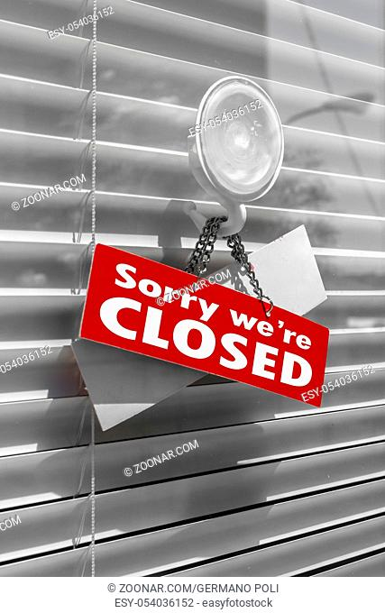Closed Sign on a door with venetian blind
