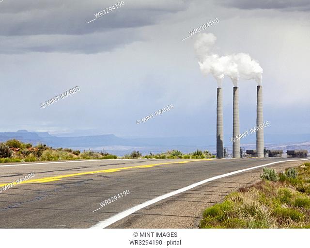 Desert Road Leading Towards Smokestacks
