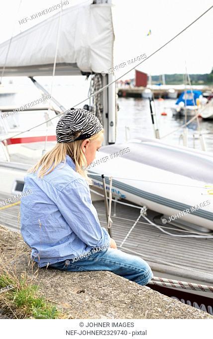 Girl sitting at marina