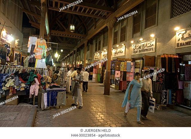 Dubaie, Bur Dubai, Corvered Souq , indian men shopping textils