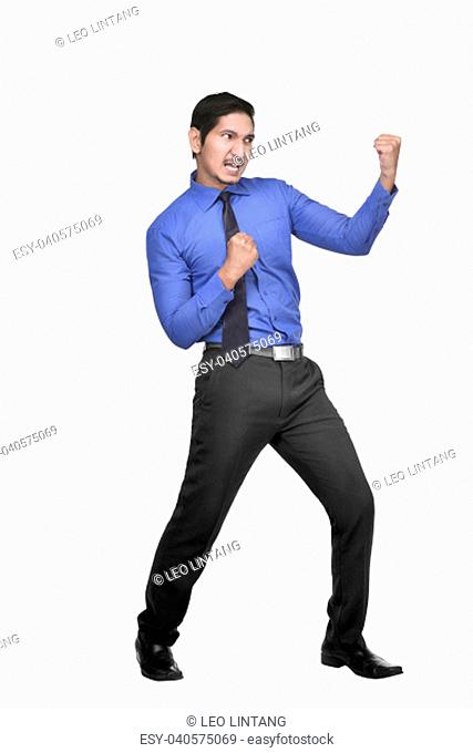 Young asian businessman with fighting stance posing isolated over white background