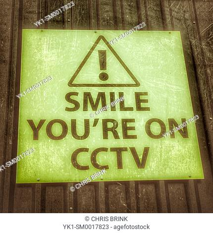 Smile you're on CCTV warning sign on outside Wall