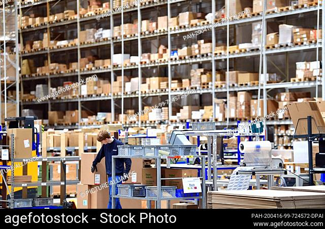 16 April 2020, Brandenburg, Großbeeren: A worker checks the goods at the logistics service provider Rhenus Warehousing Solutions SE & Co