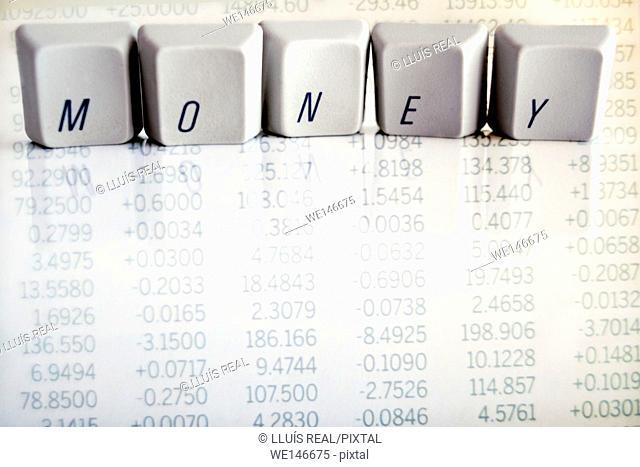 teclas de ordenador con la palabra Money, sobre un fondo de numeros de cotizacion bursatil de un periodico, computer keys with word Money