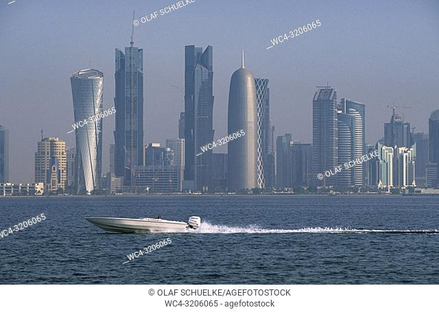 Doha, Qatar - A view from the seaside along the Corniche Promenade of the city skyline of the central business district Al Dafna