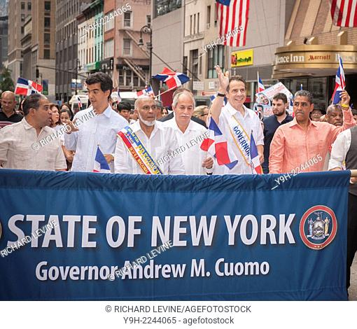 Surrounded by other politicians and dignitaries New York State Governor Andrew Cuomo, second from right, campaigns in the the 32nd Annual Dominican Day Parade...