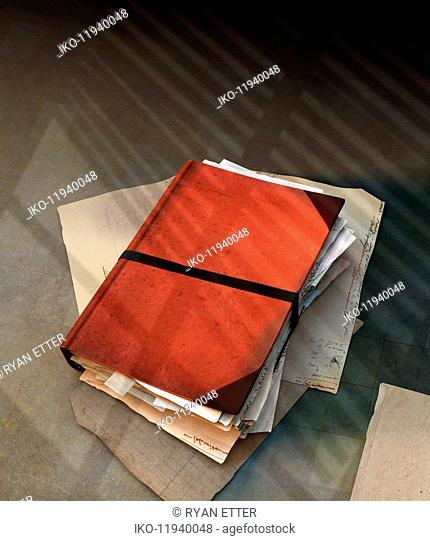 Notes and letters stuffed inside notebook