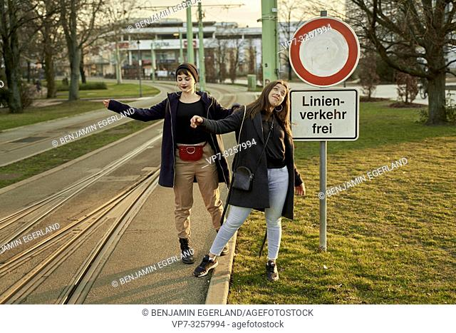 two adventurous women, at street in city Cottbus, Brandenburg, Germany