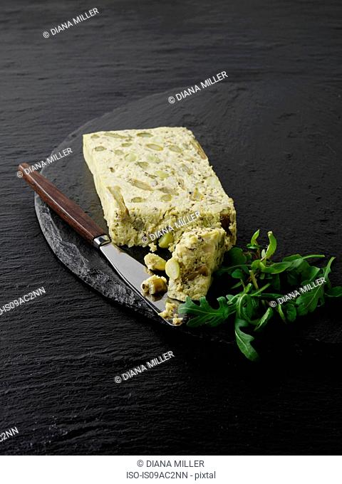 Still life with slice of asparagus, pea and edamame pate