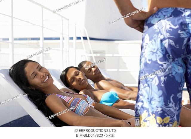 Multi-ethnic friends sunbathing